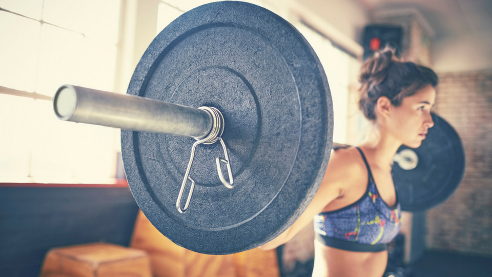 woman lifting with barbell