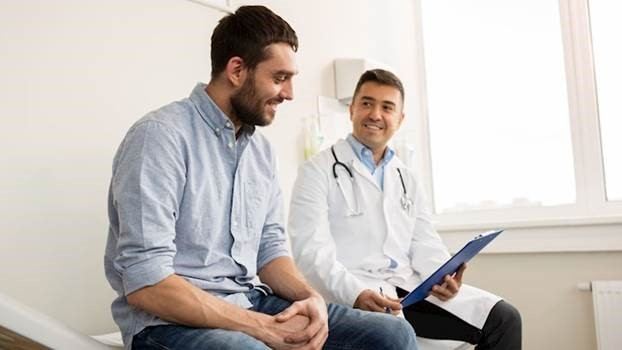 Man sitting with doctor