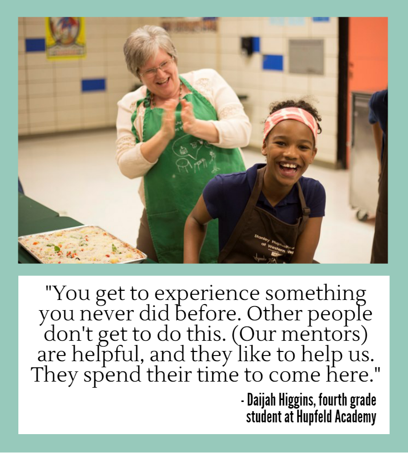 "Young student laughing with adult mentor. Daijah Higgins, a fourth grade student at Hupfeld Academy:, says ""You get to experience something you never did before. Other people don't get to do this. Our mentors are helpful, and they like to help us. They spend their time to come here."""